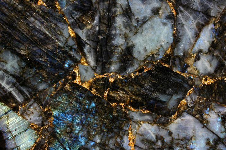 Labradorite and gold; The Antolini Preciousglitter Collection sparks the imagination of architects and designers the world over, creating forever new and exclusive colour effects.