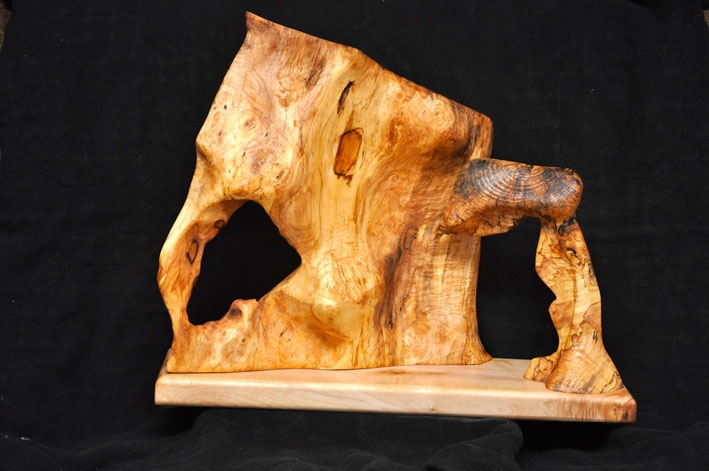 """Two pieces of spalted maple have been finished and mounted on a piece of smooth maple.  The sculpture is 62 x 20 x 50 cm tall (24"""" x 8"""" x 20"""").  It is finished with Danish oil."""