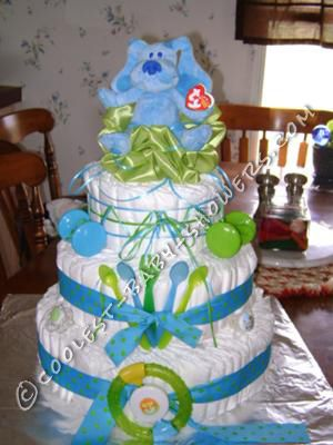 17 best images about baby shower diaper cakes on pinterest for Baby shower diaper cake decoration