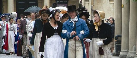 Jane Austen festival in full regency costume arriving in carriage