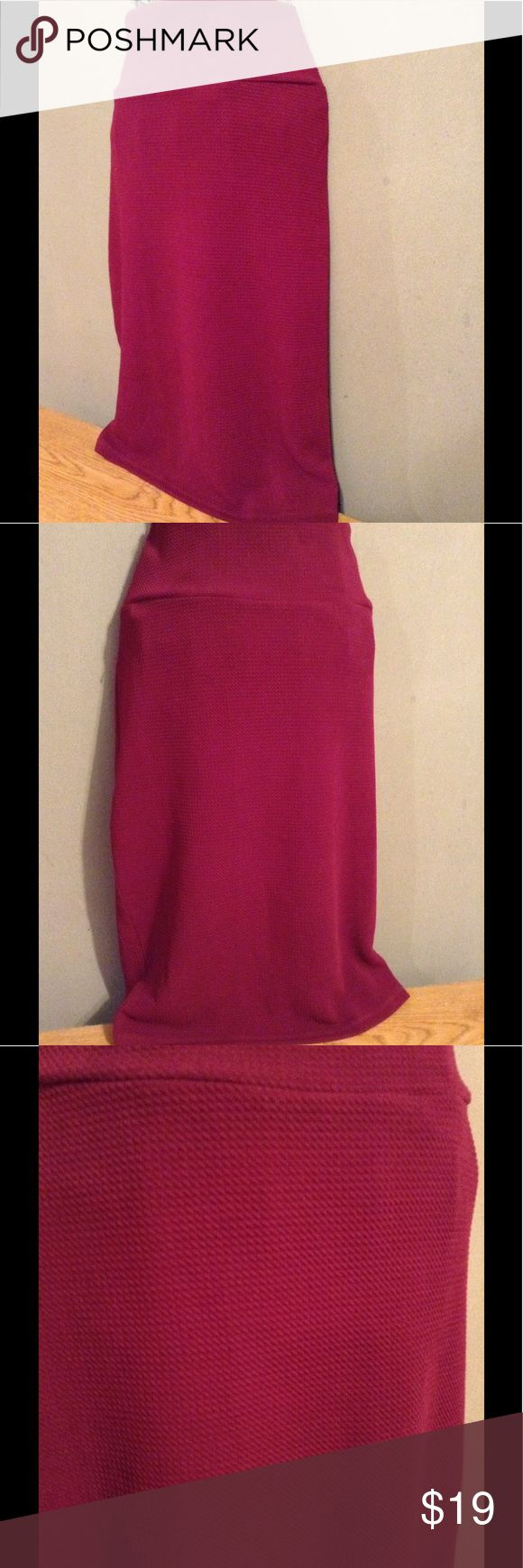 LLR Cassie Skirt Super comfy and really pretty maroon Cassie skirt. Waffle weave and light/not thick opaque material. Worn a handful of times and washed per LLR. There is an almost invisible dime sized darkening of fabrics as seen in pic 3 near waist band and priced accordingly though barely visible. Great deal! LuLaRoe Skirts Midi