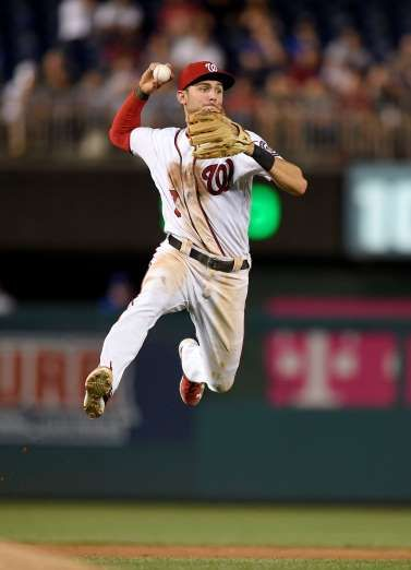JUMP SHOT: Washington Nationals shortstop Trea Turner leaps to make a throw to first to get out Chicago Cubs' Javier Baez during the ninth inning on June 28 in Washington. The Nationals won 8-4. #nationals #baseball
