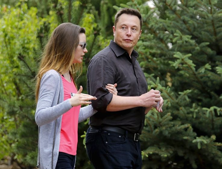 Tesla founder Elon Musk walks with his wife, British actress Talulah Riley, during the first day of the annual Allen and Co. media conference in Sun Valley, Idaho, July 8, 2015.  REUTERS/Mike Blake