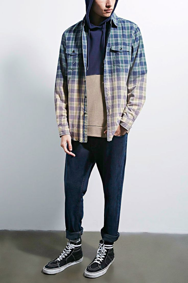 A brushed cotton plaid flannel shirt by Reason™ featuring allover paint splatters, dip dye design, long sleeves with buttoned cuffs, a buttoned front closure, buttoned chest flap pockets, a basic collar, and a frayed hem.