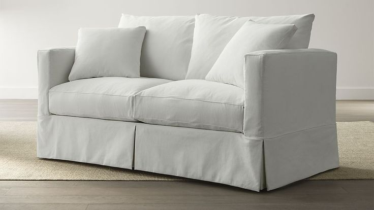 Willow full sleeper in white slipcover from Crate and Barrel for den