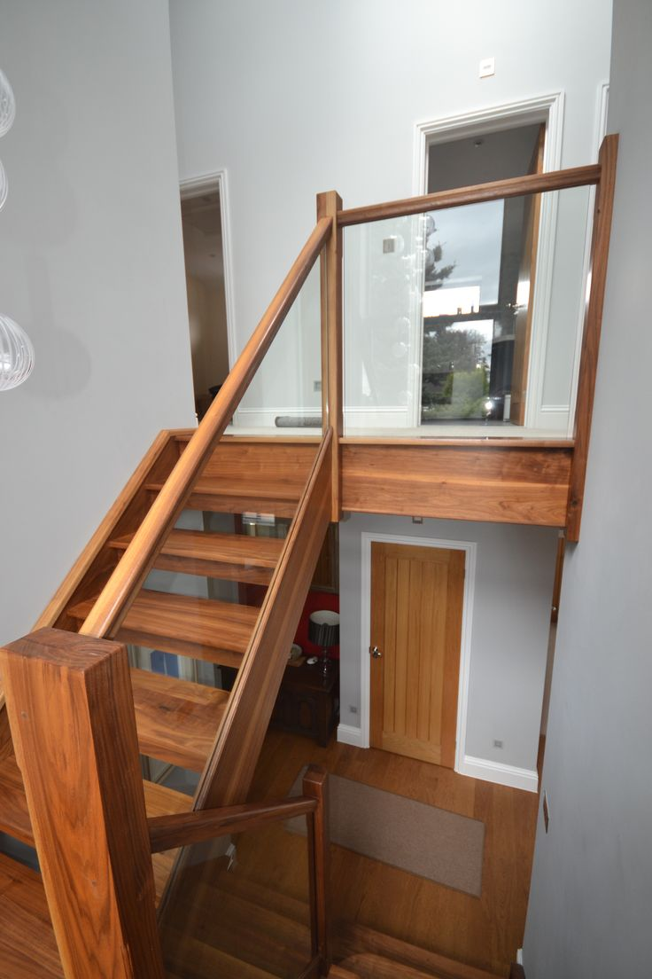 Walnut staircase with glass balustrade - simple, stunning and subtle design.