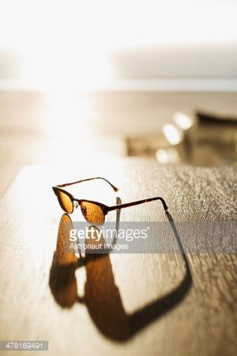 Stock Photo : Sunglasses casting shadow on table