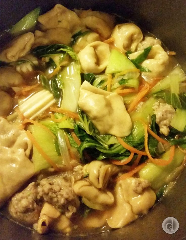 Gluten free chunky prawn & calamari wonton soup. My daughter & I need to practice our wonton folding.