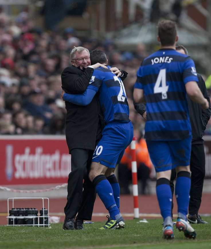 That's for you boss! Robin van Persie hugs Sir Alex after scoring the penalty