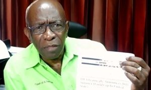 Jack Warner holding the Onion piece on his Facebook page.