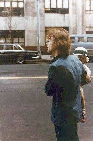 John Lennon holding Sean, waiting to hail a taxi - New York City