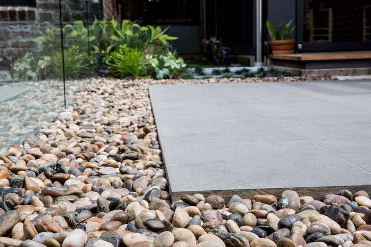 These mixed polished garden pebbles have great curbside appeal, don't need topping up every year, and provide a fantastic contrast to garden plants. Visit our website to learn the various characteristics of each stone and receive individual assistance in choosing just the right product to beautify your home and garden.  http://www.armstone.com.au/products/garden-pebbles/