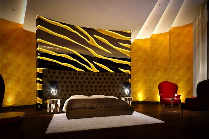 An extravagant master bedroom in tones of black, yellow and brown with a leopard pattern on the back of the giant tufted headboard.