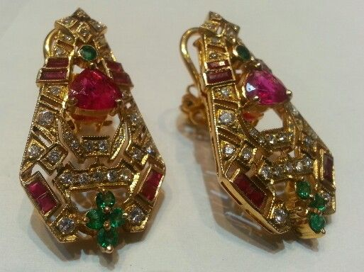 Earrings set with burmese rubies, diamonds and emeralds. India, early 20th century