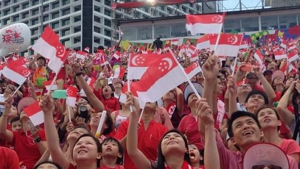 Singapore National Day Parade 2014: Spectators are transfixed by the Red Lions' display. http://www.straitstimes.com/ndp2014 Photo: Yeo Sam Jo/The Straits Times