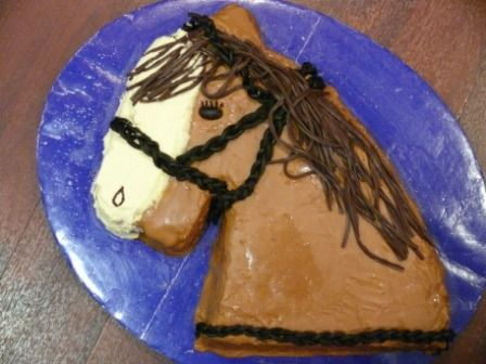 Horse head for a cake- Its a slightly disturbing idea. Several people suggested that perhaps we should have left it in our daughters bed instead of sticking candles in it!