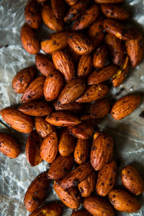 Spiced Almonds recipe with soy sauce, olive oil, rosemary, garlic, lemon zest, chili powder.