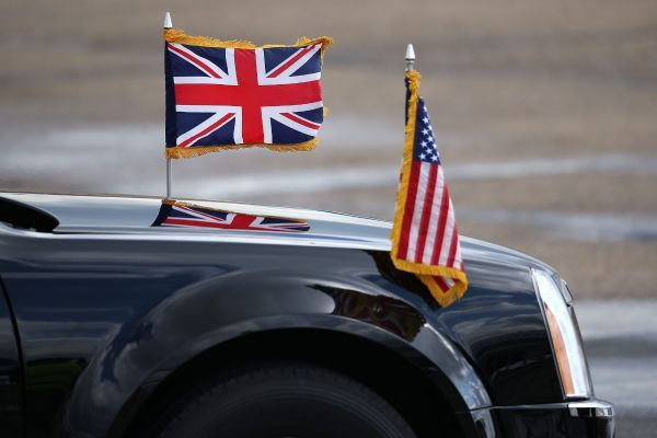 LONDON, ENGLAND - APRIL 24: The British and US flags fly from the bonnet of a car prior to the departure of US President Barack Obama at Stansted Airport, on April 24, 2016 in London, England. Mr Obama is to visit Hanover in Germany to hold talks with German Chancellor Angela Merkel before returning to the US. (Photo by Dan Kitwood/Getty Images)