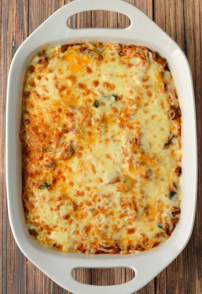 Cheesy baked spaghetti with sausage, mushrooms and spinach.