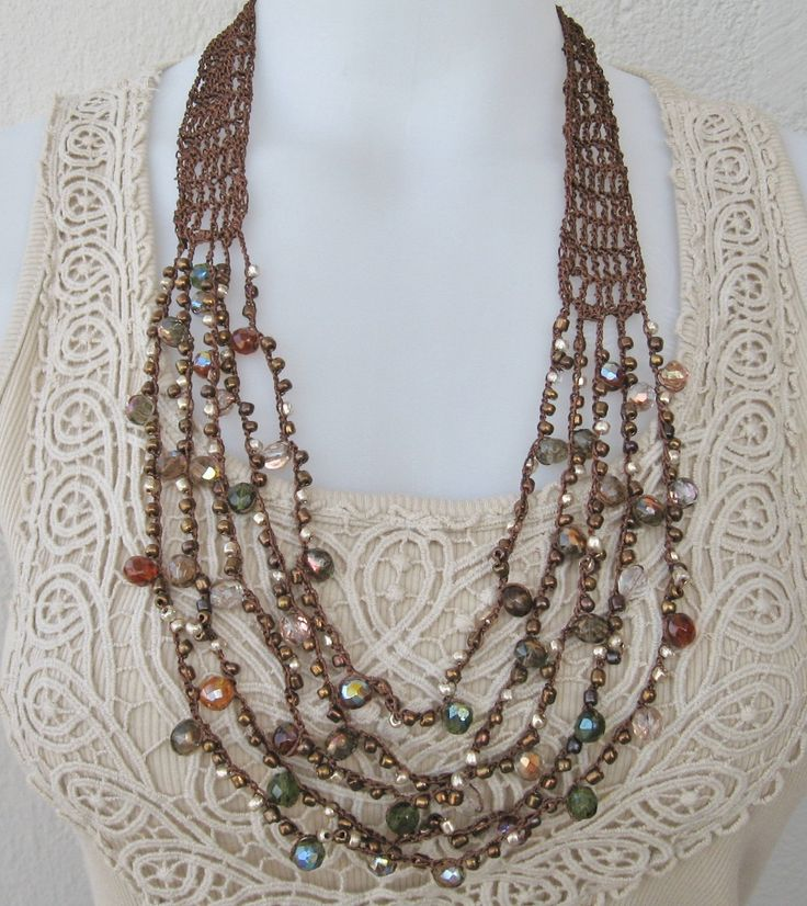 Necklace of crocheted brown thread with Czech fire-polished beads and smaller copper tone beads