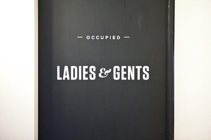 Bathroom signage at the Egan House in Seattle, Washington