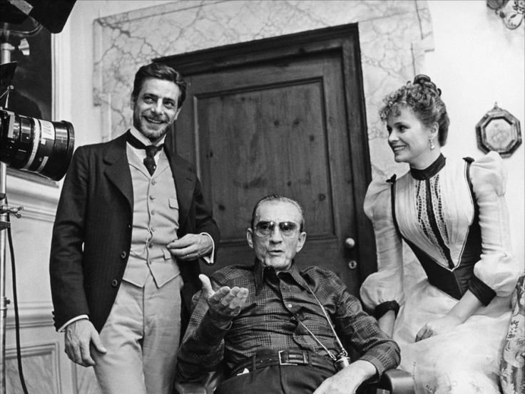 Giancarlo Gianini, Luchino Visconti and Laura antonelli on the set of L'Innocente, 1976
