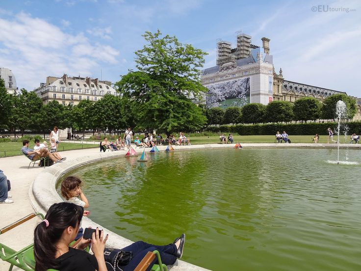 Looking to one of the smaller basins of the Tuileries Gardens, featuring model sailing boats circling the water.  Learn more; www.eutouring.com/images_tuileries_garden_47.html