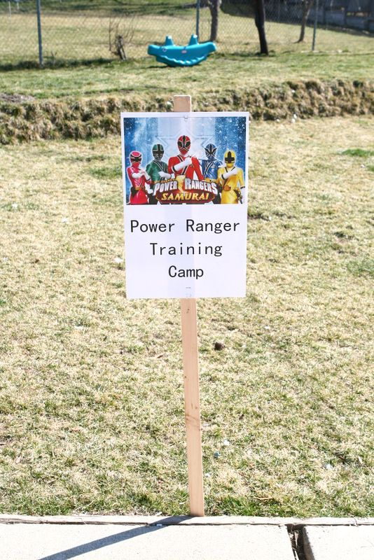 Power Ranger Target Practice! Use Party City's Power Rangers Disc Shooters and a hula hoop wrapped in streamers for the kids to shoot through.