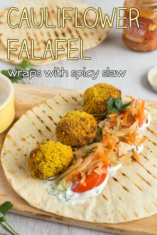 Cauliflower falafel wraps with an easy garlic yogurt dip and spicy slaw. These cauliflower falafel are only 65 calories each, and each one contains over 20% of your RDA of vitamin C! So easy to make, and so healthy.