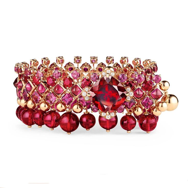 Chaumet Est une fête Aria Passionata rhodolite garnet bracelet in fiery red with pink tourmalines, rubies and diamonds. http://www.thejewelleryeditor.com/shop/product/chaumet-est-une-fete-aria-passionata-rhodolite-garnet-bracelet/ #jewelry