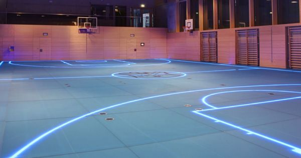 Sports spaces are increasingly being used for multiple activities… one floor could be used for basketball, and an hour later used for a volleyball game. In an ever increasing effort to squeeze the most amount of use, function and cost efficiency out of our gym spaces one thing truly holds us back: painted lines.