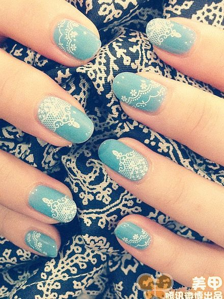 Powder blue nails with white lace design