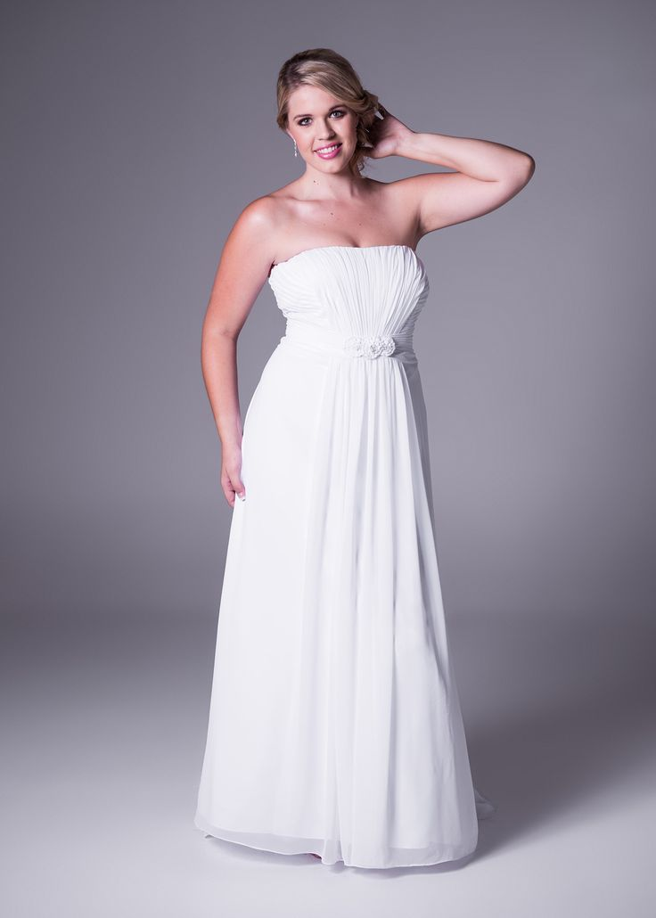 Available in ivory or white, this strapless soft chiffon #wedding dress feels and moves like it looks. The waterfall detail completes your dream look! Style: 9WG3128. Click to View More or Book a Fitting.