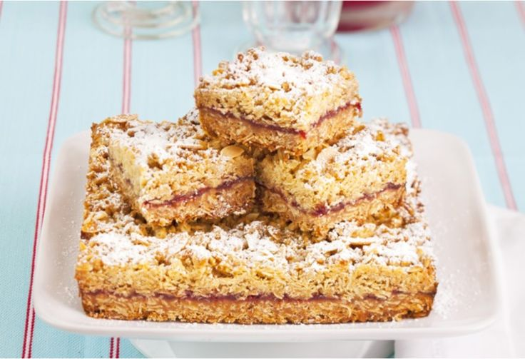 Raspberry crumble slice A wonderfully sweet slice that's easy to whip up and makes enough for leftovers.