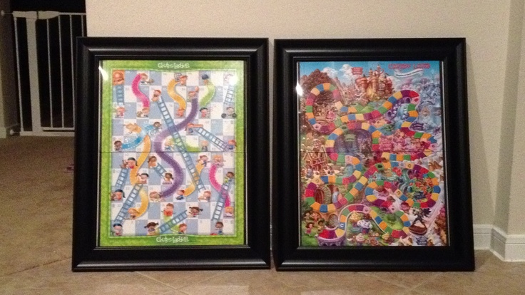 Bought cheap picture frames from Walmart and put in Chutes & Ladders and Candy Land board games. Functional wall art! Game pieces in Ziploc baggies on the back.