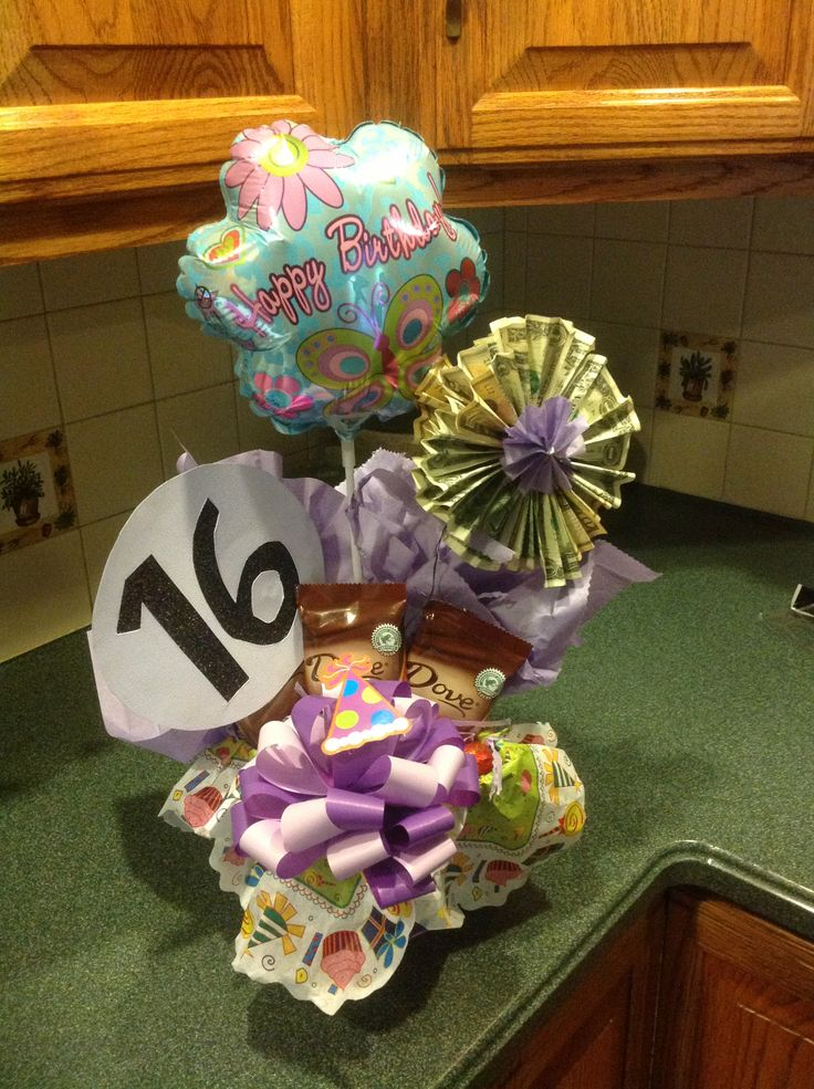 Money flower 16 th birthday gift with Lauren's favorite candy ....dove choc bars and squares.