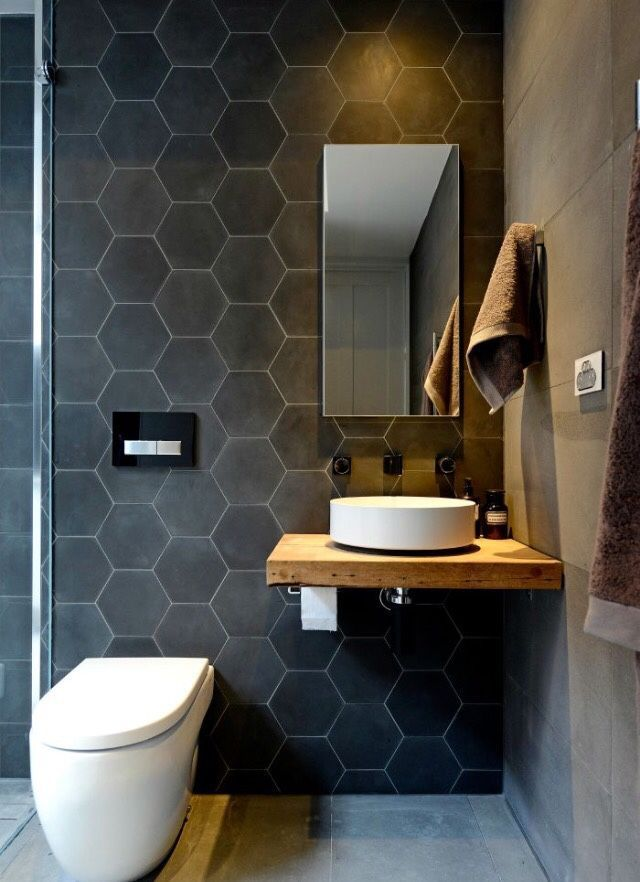 geometric tile wall with floating vanity