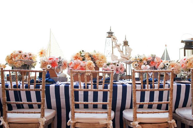 Keep the nautical look alive with non-traditional center pieces and pin striped linens! #Nauticalwedding #Stripes #Boats #Centerpieces #Wedding #