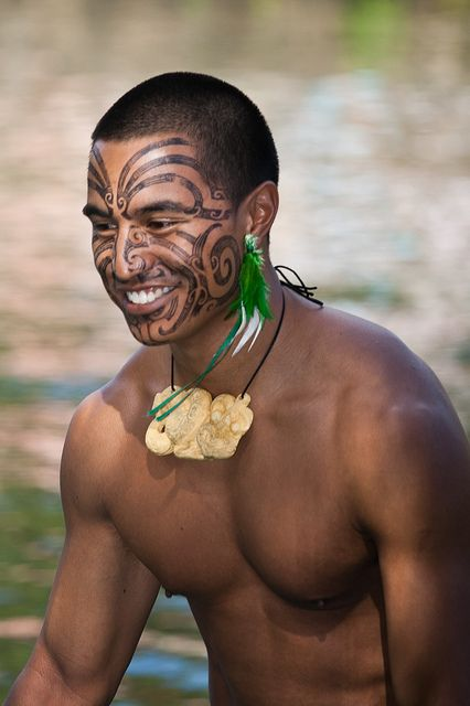Maori Even with the haka covering his face, this man's smile brightens the world, and that's the sexiest thing any man has going for him.  The muscles and assorted toned body parts are sides or toppings, that smile is the meal.