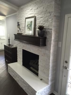 Fireplace makeover: Crystal White Quartzite 6x24 Interlocking Ledger Panel by janette