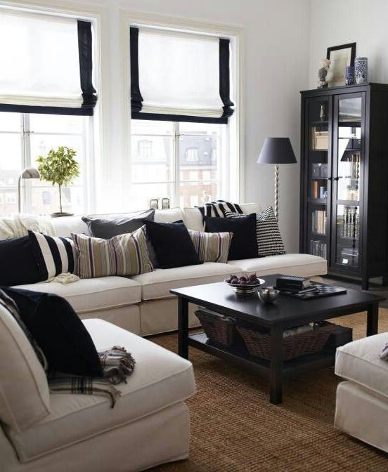 white living room design  Love those black trimmed Roman shades.