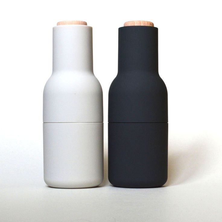Salt & pepper bottle grinders by Norm Architects for Menu. Tactile, stylish, practical (and no more unsightly pools of salt and pepper left on the table).