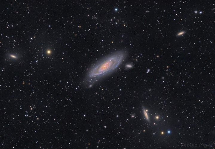 The View Toward M106 - A big bright beautiful spiral Messier 106 is at the center of this galaxy filled cosmic vista. The two degree wide telescopic field of view looks toward the well-trained constellation Canes Venatici near the handle of the Big Dipper. Also known as NGC 4258 M106 is about 80000 light-years across and 23.5 million light-years away the largest member of the Canes II galaxy group. For a far away galaxy the distance to M106 is well-known in part because it can be directly…