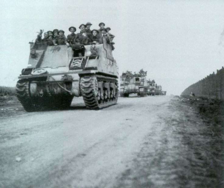 A column of Kangaroo armored personnel carrier converted from M7 Priest self-propelled artillery vehicles, France, Aug 1944