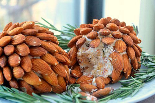 """After I made these """"pinecone""""-looking Cheese Balls for our Christmas pot luck lunch, they started calling me """"Martha Stewart"""" at work.... I added lump crab meat to mine in place of the pepperoni."""