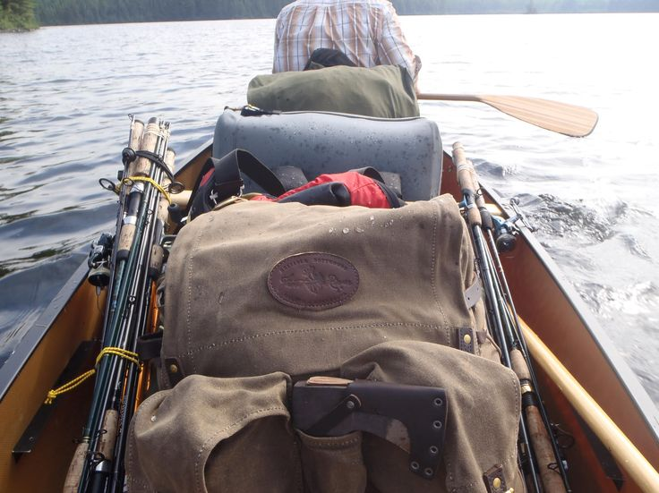 Love looking out at a wide open lake over a canoe full of gear in the Boundary Waters. Each canoe is different, and here's a full load of fishing and living gear in a kevlar canoe with waxed canvas Frost River Isle Royale front and center. Access to the BWCA is by permit only, and you can pick yours up at Frost River in Duluth, Minnesota.