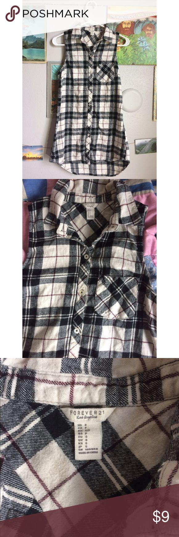 Forever 21 plaid flannel tunic shirt Forever 21 soft flannel sleeveless tunic (or shirt dress depending on how tall you are). Forever 21 Tops Button Down Shirts