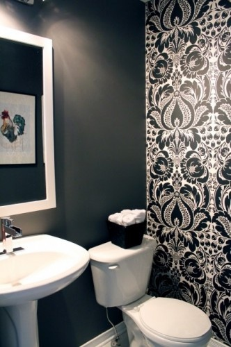 Bold black and white wall paper, with stunning Pfister Vega faucet