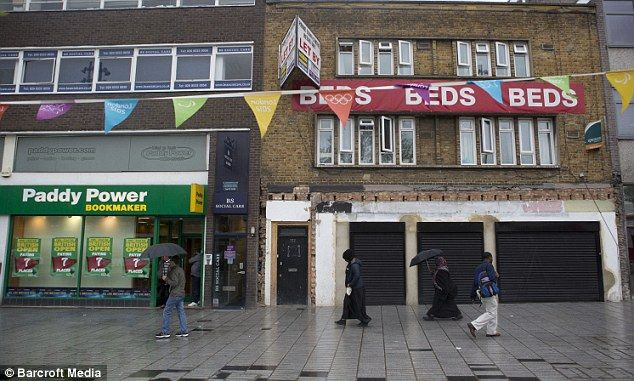 A bed shop is closed with shutters drawn down in Stratford town centre