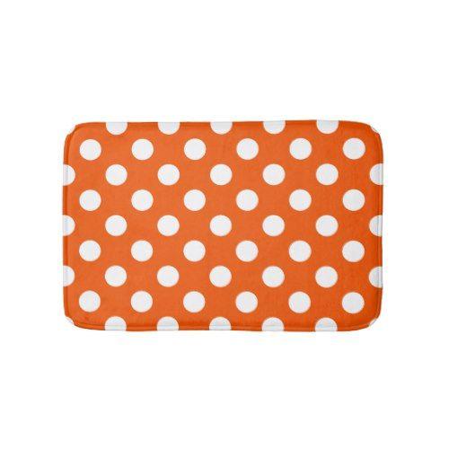 White polka dots on orange bath mat